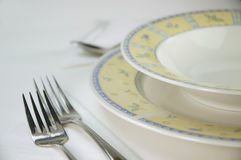 Plate and forks. Plates and forks set on the table for dinner Royalty Free Stock Photos