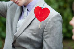 The plate in form of heart. The plate in the form of heart in a pocket at the man Stock Photo