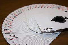 Plate-forme de tisonnier jouant des cartes Images libres de droits