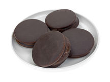 Plate of four chocolate snack cakes Stock Image