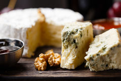 Plate of french cheeses close-up Stock Photos