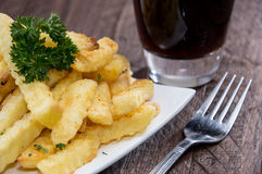 Plate with french fries on wood Stock Photo