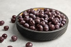 Plate with fresh acai berries. On table royalty free stock photos
