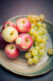 Plate with fresh autumnal fruits. apples in selective focus Royalty Free Stock Photos