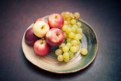 Plate with fresh autumnal fruits. apples in selective focus Stock Image
