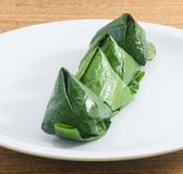Plate of Fresh BetelLeaf Wrapped Bite Size Appetizer Stock Photo