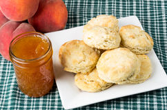 Plate of fresh biscuits with peach jam Stock Photography