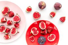 Plate of fresh blue figs on white background top view Royalty Free Stock Photos