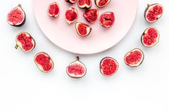 Plate of fresh blue figs on white background top view copyspace Royalty Free Stock Photography