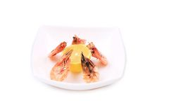 Plate with fresh boiled shrimps and lemon. Stock Images