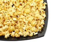 Plate with fresh caramel popcorn. Isolated Stock Photos