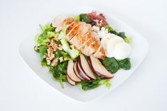 Plate of fresh chopped grilled chicken salad. On a white background Stock Photography