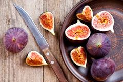 Plate with fresh figs and old knife Royalty Free Stock Photography