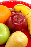 Plate of fresh fruit. Closeup of some fresh fruit on a red plate royalty free stock photography