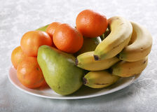 Plate of fresh fruit Royalty Free Stock Image