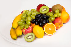 A plate of fresh fruit closeup. Healthy eating, diet and vitamins Royalty Free Stock Images