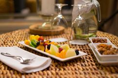 Plate with fresh fruits and refreshing drink Royalty Free Stock Photo
