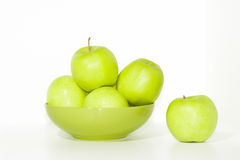A plate of fresh green apples Stock Images