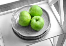 Plate with fresh green apples Stock Image