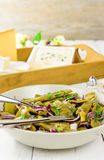Plate of fresh green beans and red onions Royalty Free Stock Images