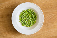 Plate of fresh green peas Stock Image