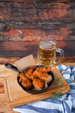 A plate of fresh, hot, crispy fried chicken with red sause on a Stock Photo