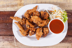 A plate of fresh, hot, crispy fried chicken