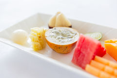 Plate of fresh juicy fruit dessert at restaurant Stock Image