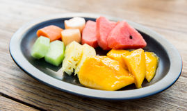 Plate of fresh juicy fruits at asian restaurant Royalty Free Stock Image