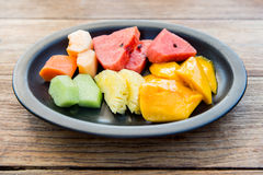 Plate of fresh juicy fruits at asian restaurant Stock Images