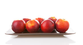 Plate with fresh nectarines Stock Photography