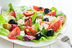 Plate of fresh salad with feta and olives Stock Image