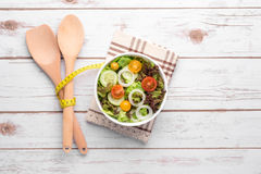 Plate with fresh salad, knife and fork. Diet food Stock Images