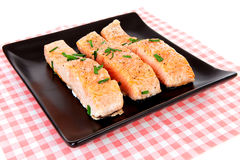 Plate with fresh salmon on checkered napkin Stock Photography