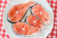 Plate of fresh salmon and lemon slices Royalty Free Stock Images