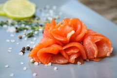 Plate with fresh sliced salmon fillet. Closeup stock photos
