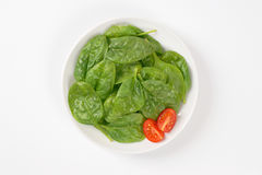 Plate of fresh spinach Stock Photo