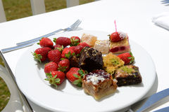 The plate with fresh strawberries and Turkish delights in hotel Stock Photo