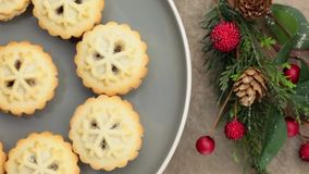 Plate of fresh sugar coated mince pies rotating stock footage