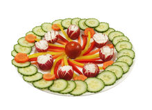 Plate full with fresh vegetables. Plate with fresh vegetables, carrots,cucumbers,peppers,radishes and tomato on a white background Stock Image