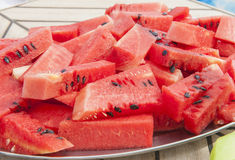 Plate of fresh water melon fruit. Closeup detail of fresh water melon fruit slices on a plate Royalty Free Stock Image
