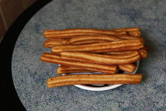 Plate of Freshly Baked Churros Royalty Free Stock Photos