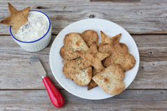Plate of freshly baked tortilla chips and spinach dip. Royalty Free Stock Photo
