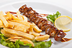 Plate of freshly prepared kebabs and fries Stock Photography