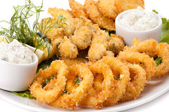 Plate of fried in batter squid and mussels Stock Images