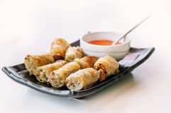 A plate of fried chinese spring rolls with chili sauce Royalty Free Stock Images