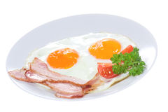 Plate with fried egg, bacon vegetables Stock Image