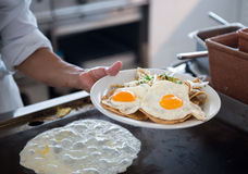 Plate with fried eggs Royalty Free Stock Photography