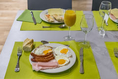 Plate of fried eggs and sausages in a restaurant Royalty Free Stock Image