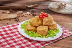 Plate of fried fish balls with cabbage on the table in restauran Stock Images